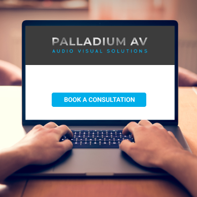 Man booking smart home consultation on Palladium AV website.