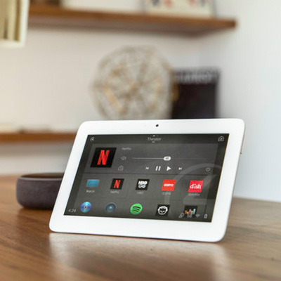 Home automation system by control4, tablet on table that controls all devices in the home.
