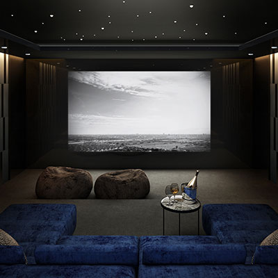 Modern home cinema system with luxury sofa seating and bean bags.
