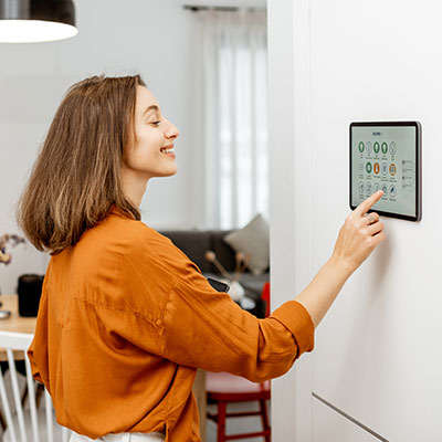Young women uses our smart home system in her living room.